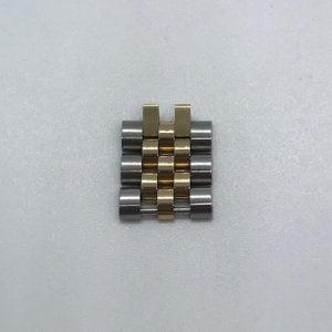 Rolex Jubileum schakel Geelgoud staal 15,3 x 8,0 x 2,9 0969